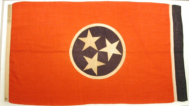 Tennessee history, The Tennessee Historical Society's collection includes a number of flags, including the original state flag designed by Lee Roy (LeRoy) Reeves of Johnson City in 1905.